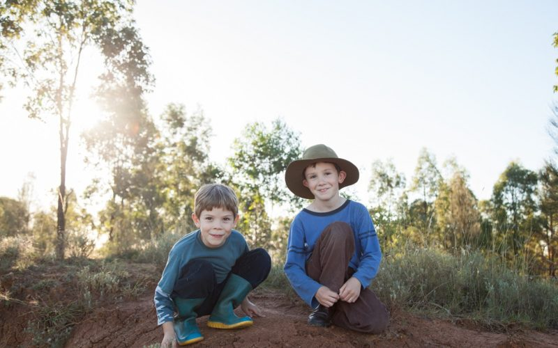 Boys in the bush smiling